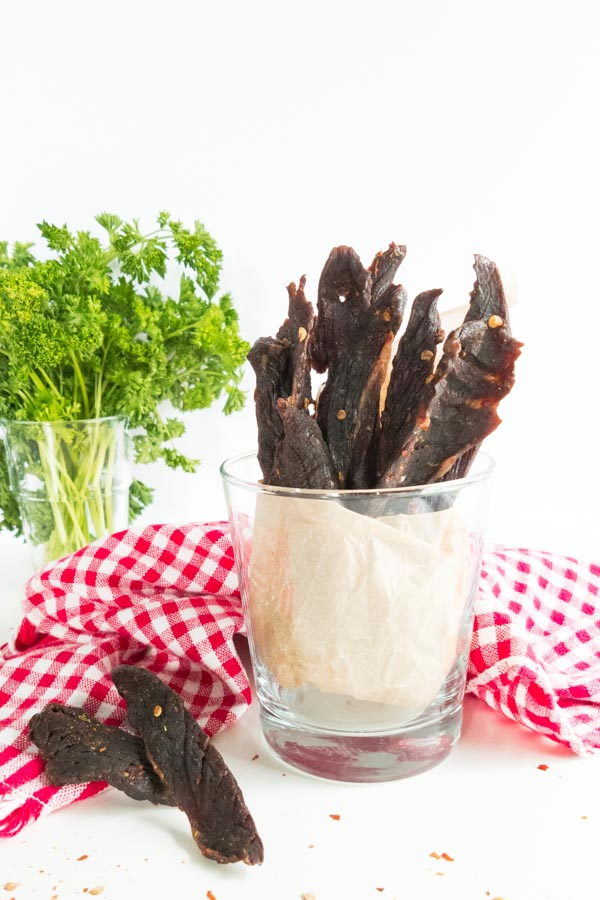 Oven Baked Chili Lime Beef Jerky in a glass for serving